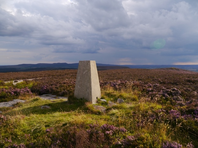 The trig point on Long Crag looking towards the Simonside Hills
