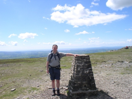 Matt by the trig point on Ingleborough