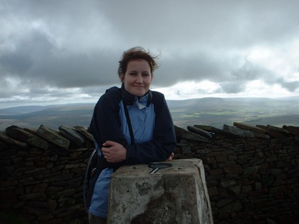 Lisa by the trig point on Whernside