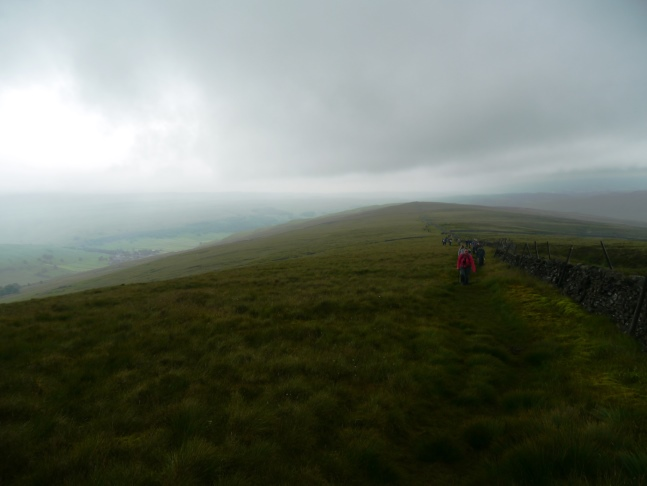 Looking back at the line of walkers on Old Cote Moor
