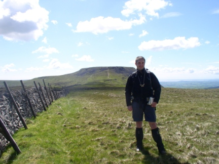 Matt on the unmarked top of Simon Fell with Ingleborough behind