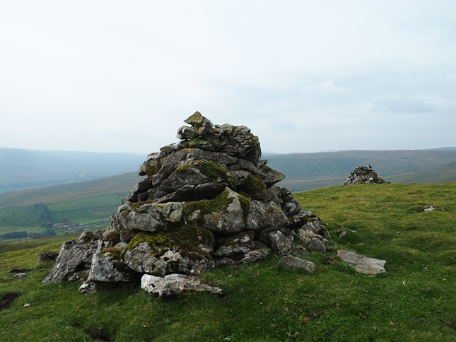 Two old, moss-covered cairns on Pike Hill