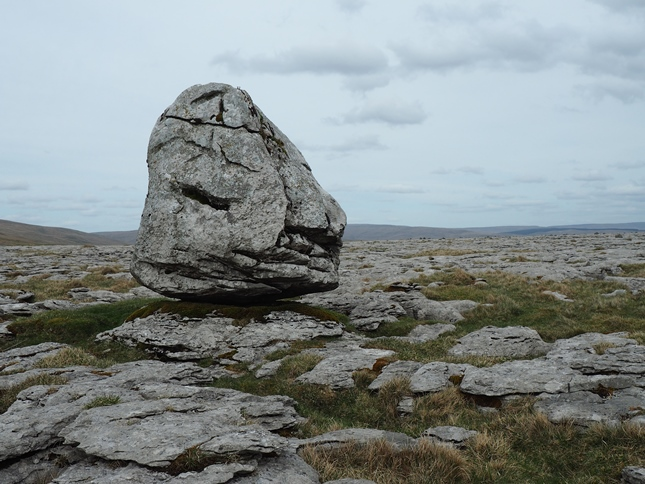 A large boulder on the limestone pavement of Scales Moor