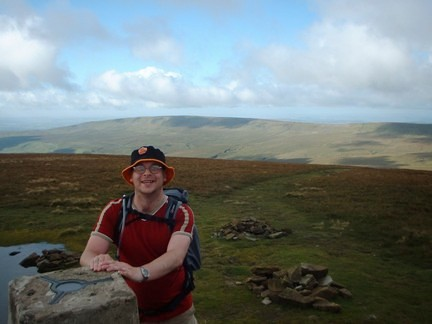 Standing by the highest point in Yorkshire with the long ridge of Gragareth behind me
