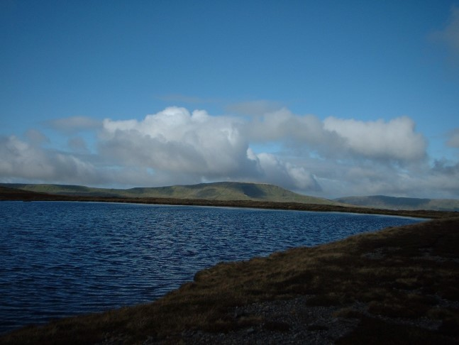 By one of the Whernside tarns looking towards Great Coum
