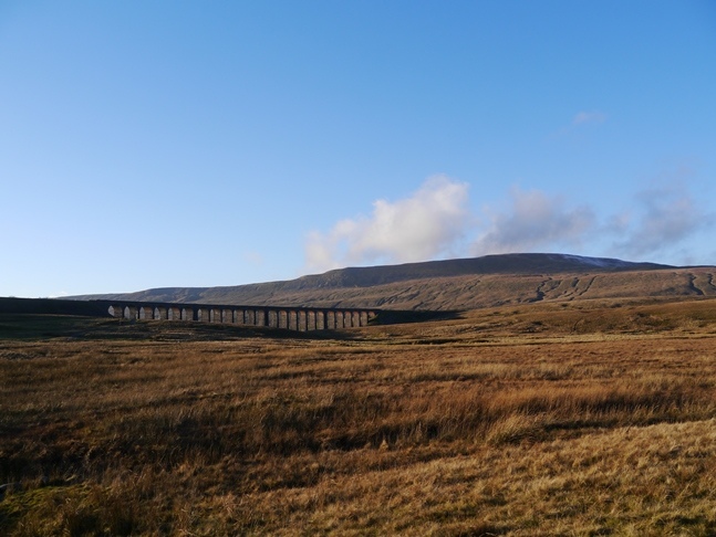 The classic view of Whernside with Ribblehead Viaduct in the foreground