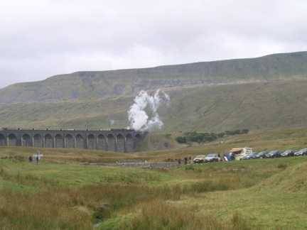 A steam train crosses the Ribblehead viaduct