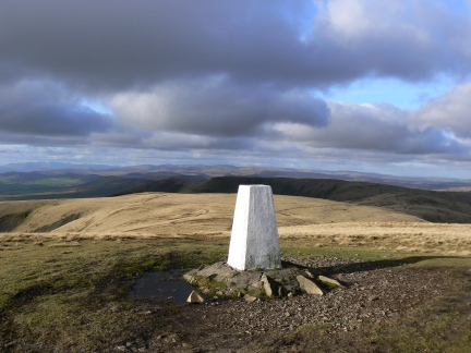 The summit of The Calf looking across Fell Head to the Lake District