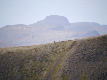Two walkers on the Great Rigg to Fairfield ridge with Great Gable behind