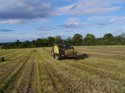 Farmer collecting hay near Sawley