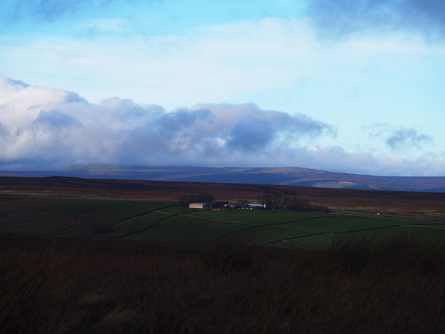 The view north-west towards a cloud topped Mickle Fell